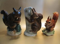 Three porcelain perfume lamps (Rauchverzehrer) in the shape of squirrels