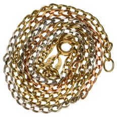 Tri-colour gold curb link necklace of 14 kt