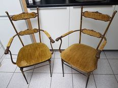 Two antique bronze/brass armchairs