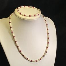 Necklace with freshwater mini-pearls and ruby spacer beads – sterling silver clasp