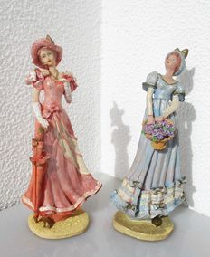 Set of 2 antique lady figurines