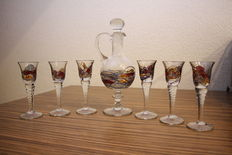 Six unique glasses with matching decanter