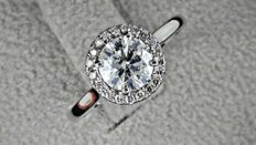 IGL 1.10 ct round diamond halo ring made of 14 kt white gold