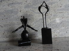 Two beautiful, heavy bronzed sculptures on marble pedestals
