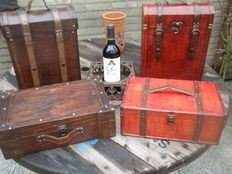 Four beautiful wooden wine cases finished with leather / brass fasteners.