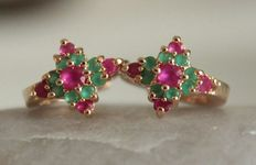 Gold earrings with rubies and emeralds
