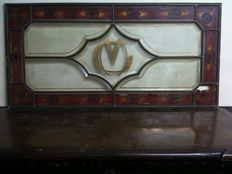Old small brass bound glass panel with bevelled glass and colours that need restoring