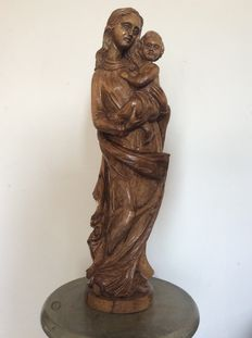 Walnut sculpture of a Madonna and Child
