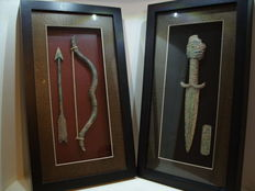 Two archaeological decorative objects
