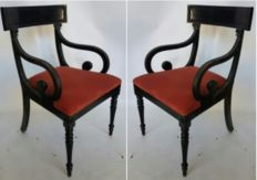 Pair of elegant black lacquered English chairs with armrests, London, approximately 1970