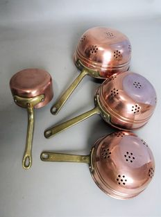 Three red copper strainers + a red copper saucepan marked copper cook Belgium.