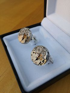 Cufflinks with watch movement, nearly new and never worn.
