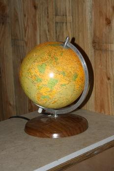 Globe on metal stand, with lighting