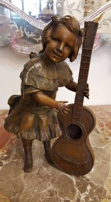 Antimony sculpture of a little girl with cello - France - first half of the 20th century