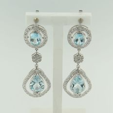 White gold dangle earrings set with blue topaz and brilliant cut diamond