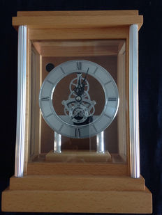 Clock with visible movement in wood case