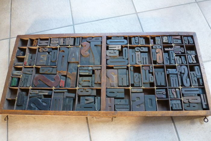 old letter tray from a letter cabinet of a printing company with