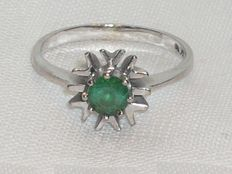 White 14 kt gold ring with emerald.