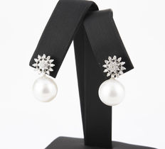 White gold earrings in a sun design, with diamonds and 12 mm Australian South Sea pearls