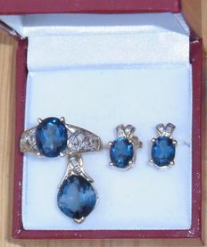 Designer jewellery, 9ct. Gold set consisting of ring, pendant and earrings with London Blue topaz + diamonds NO RESERVE PRICE