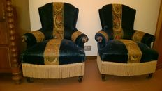 A pair of Napoleon III covered armchairs, circa 1900