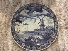 Three large antique plates by Boch