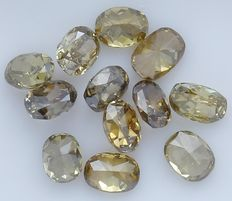 12 Oval Brilliant Yellow Color  Diamonds – 1.67 ct.