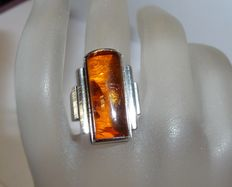 A ring made of 835 silver by Fischland jewellery with Baltic Sea amber and Fisch hallmark