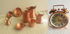 Set of copper alarm clock and copper pans