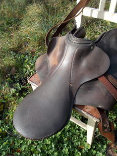 Very old horse saddle, full leather, for decorative purpose only
