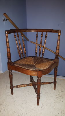 Wooden spindle-back corner chair with rush seat