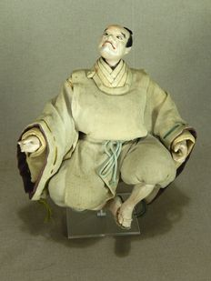 Sitting samurai doll made of wood and textile – Japan – 19th century
