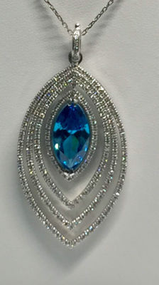 Gold pendant decorated with a synthetic blue stone surrounded by 3.60 ct of Top Wesselton diamonds.