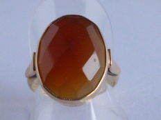 Gold ring with faceted cut carnelian