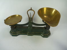Cast iron scales with brass bowls.
