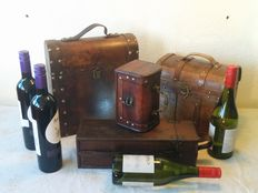 Four luxury suitcases-two wine cases (four bottles) and two suitcases (small bottles)-executed in wood, brass and leather