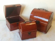 Three luxury boxes, wooden cases carried out in lacquer.