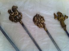 13 Old stainless steel meat skewers with brass handles with various depictions