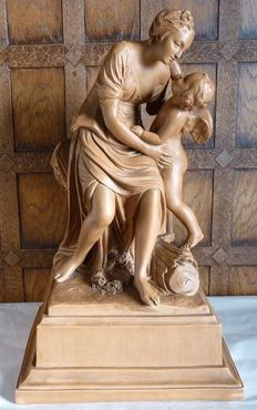 A terracotta sculpture of a lady and amor, made recently