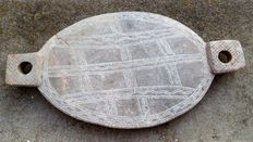 old traditional Awale plate in engraved stone
