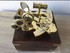 Brass sextant in wooden box