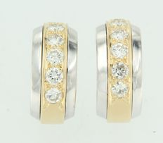 Bicolour, 18 kt gold, creole earrings, set with 12 brilliant cut diamonds in total.
