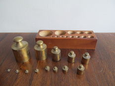 Large wooden weights block with 11 brass weights