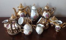 Three times 22 k gold plated porcelain Mocha service with romantic decor