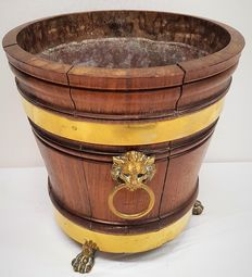 Wooden cheese barrel with brass inlay on lion paws