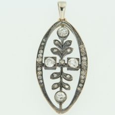 Gold with silver pendant in floral pattern, set with old cut diamond.