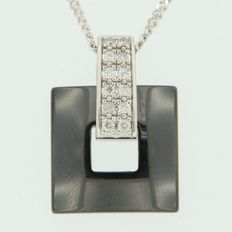 14 kt white gold necklace and 18 kt gold pendant set with diamonds and hematite; necklace length: 45 cm