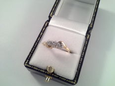 Yellow and white gold ring with brilliant cut diamond.