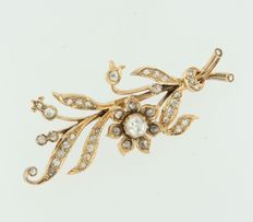 14k rose gold branch brooch set with various rose cut diamonds of in total approx. 0.70 carat