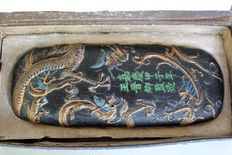 Ink stone (rubbing stone) with painted dragons that wind around the stone - China - end of the 20th century
